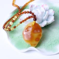瑞祥琥珀 波罗的海蜜蜡 蜜蜡带皮寿桃挂件 12.67g