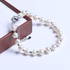 御鑫骋珠宝 时尚饰品 精美珍珠手链 白色扁圆珠淡水珠 6-7mm