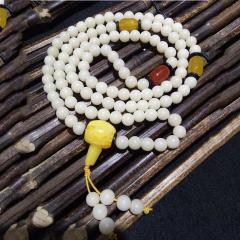 菩提居珠宝行 圆7菩提根108颗,搭配红,黄玛瑙,二代蜜蜡三通,椰壳隔片